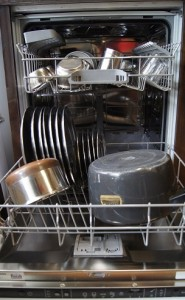 Dishwasher loaded with utensils