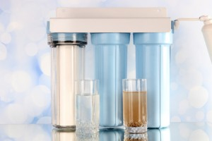 Filter system for water treatment with glasses of clean and dirty water on bright background